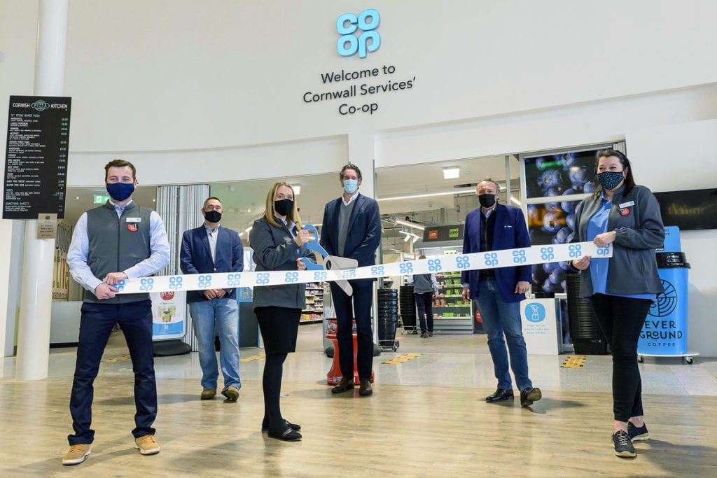 Co op store manager Erica Smedley cutting the ribbon